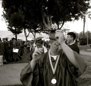 A group of graduates prepares for commencement ceremonies.