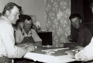 Chick (in the middle) playing dominoes. This was always serious business.
