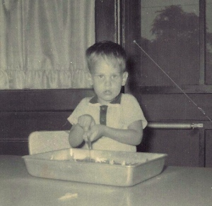 In the kitchen at an early age. I had already decided what I liked and what I didn't.